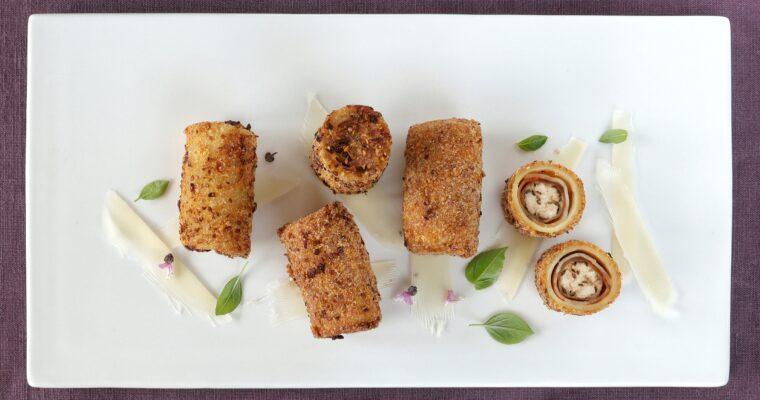 Paccheri fritti ripieni di Perlina e Speck con polvere di Datterino Giallo e Alta Badia profumati al Basilico alpino